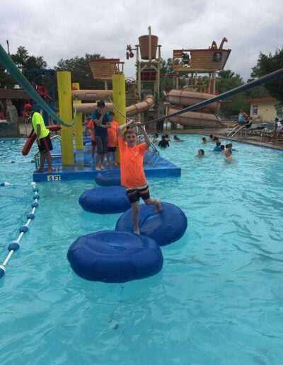 Boy playing at a water park