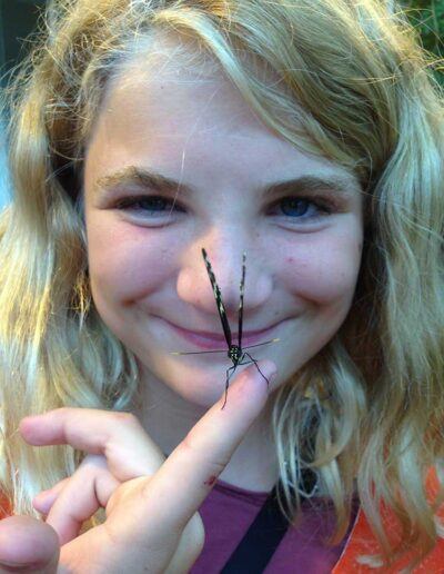 Girl holding a butterfly