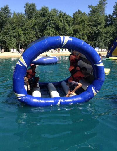 Kids playing on a rolling water toy