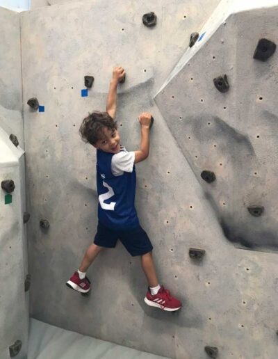 Boy climbing a rock wall at the Black Earth Children's Museum