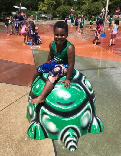 Boy playing in the water at a splash park