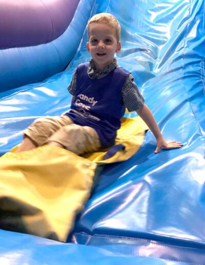Boy sliding down a bouncy slide