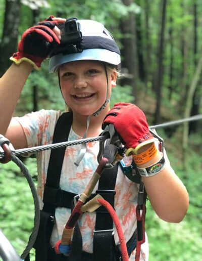 Girl getting ready to go on a zip-line